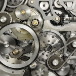 What Do You See:  The Face of God or Cogs in a Machine?